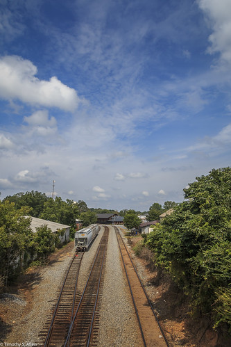 westgeorgia buildings rail railroad tracks sky clouds blue landscape cityscape carrollton georgia