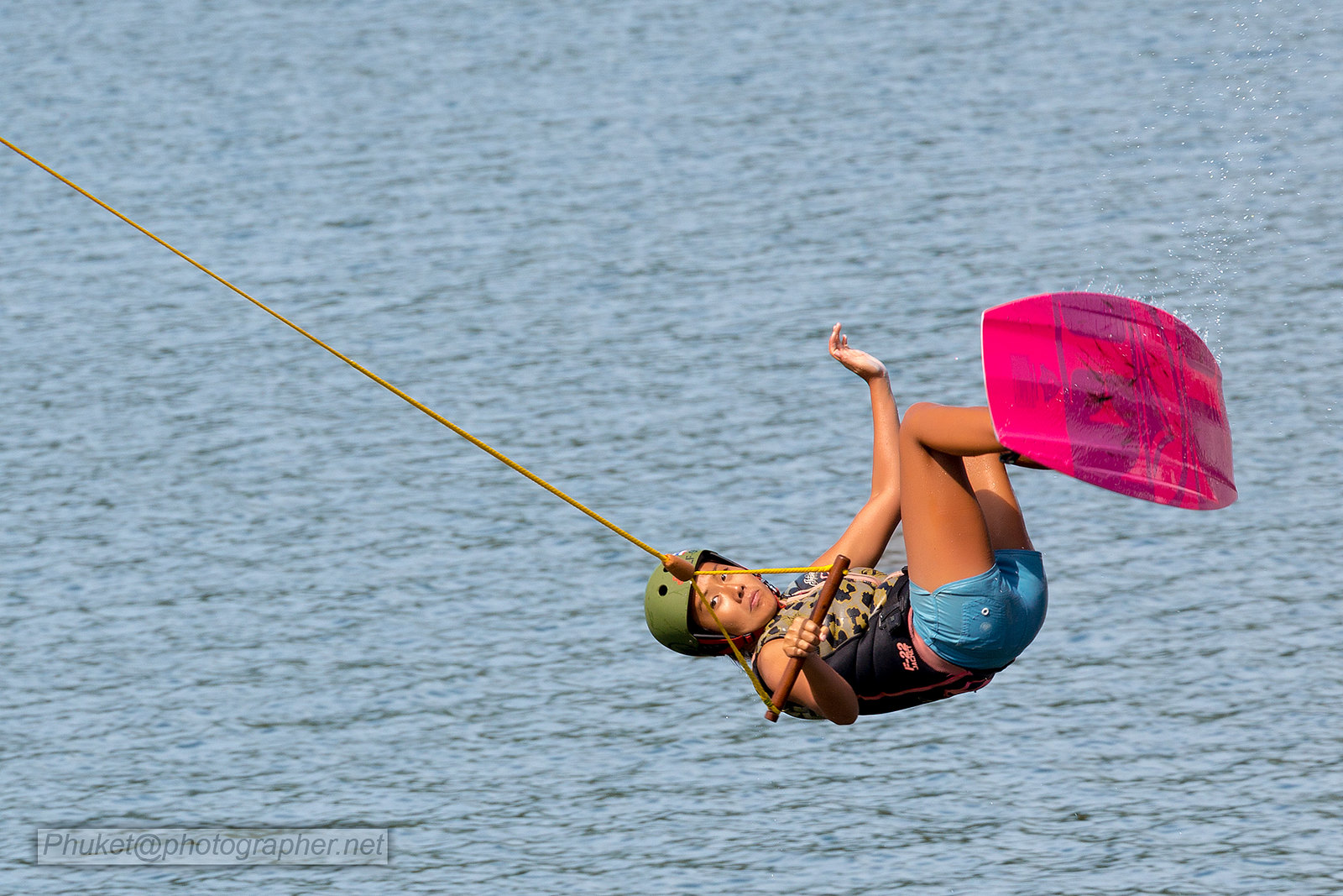 Girl jumping on a wakeboard