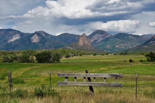 needlerock geology geologic formation fence rural farmland clouds