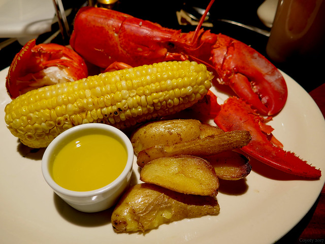 Steamed Maine lobster with roasted potatoes and corn on the cob