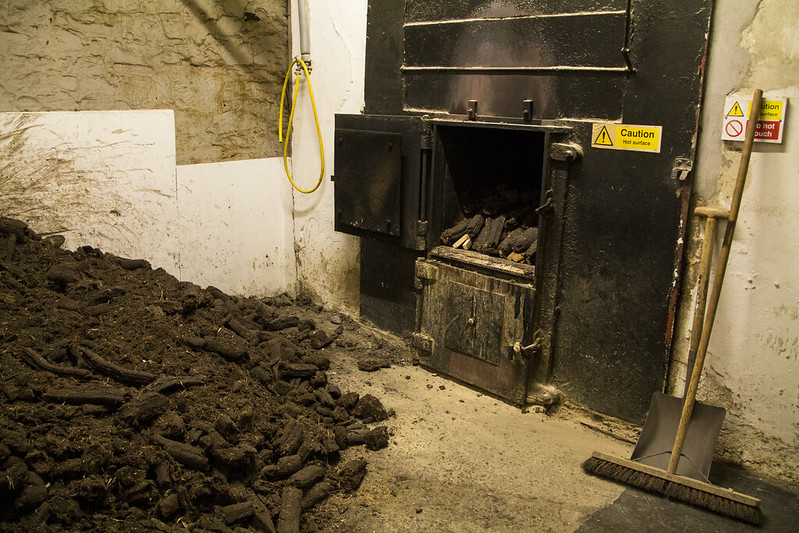 Piles of peat are dried and ready for the kiln to infuse the barley with flavor