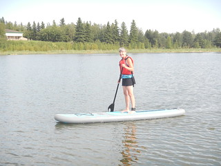 Elk Island Linda on Paddleboard standing | by Pierre Yeremian