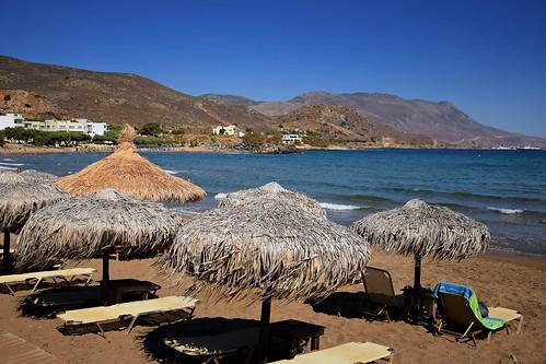 holiday sea water waves mediterranean blue beach sand sandy parasol umbrella landscape view nature hill mountain gramvousa peninsula kissamos castelli crete kriti kreta greece greek island sunny hot bay bayofkissamos
