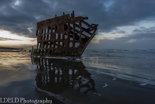 peteriredale fortstevens graveyardofthepacific sunrise ocean beach shipwreck clouds sand waves reflections morning dawn clatsop oregon pacific