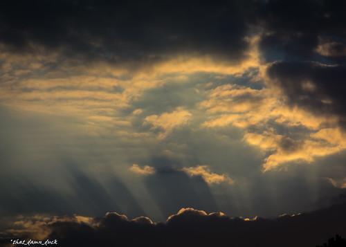 sunrays sundown sunset clouds nature
