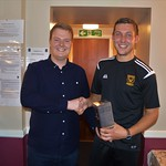 Man of the match Michael Clark receives his award from Charles Stewart from sponsors Rigmarine