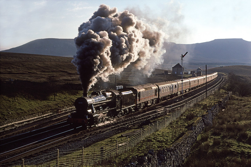 The crew of 8F 48151 seem to have everything under control as she slogs past Blea Moor with The Cumbrian Mountain Express on the 26th November 1988.  I have managed to remove the dust but cannot do much about the Ethel and raspberry ripple coaches I am afraid.  Pentax S1A. Kodachrome 64.