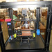A 3-D printer . State Librarian Beverly Cain and Bill Morris visited the Toledo Lucas County Public Library (TLCPL) on July 27, 2017