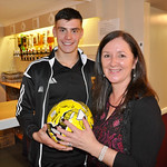 MOM Glenn Murison presents match sponsors Ryden with a signed ball