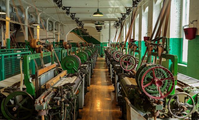 Weaving looms at work