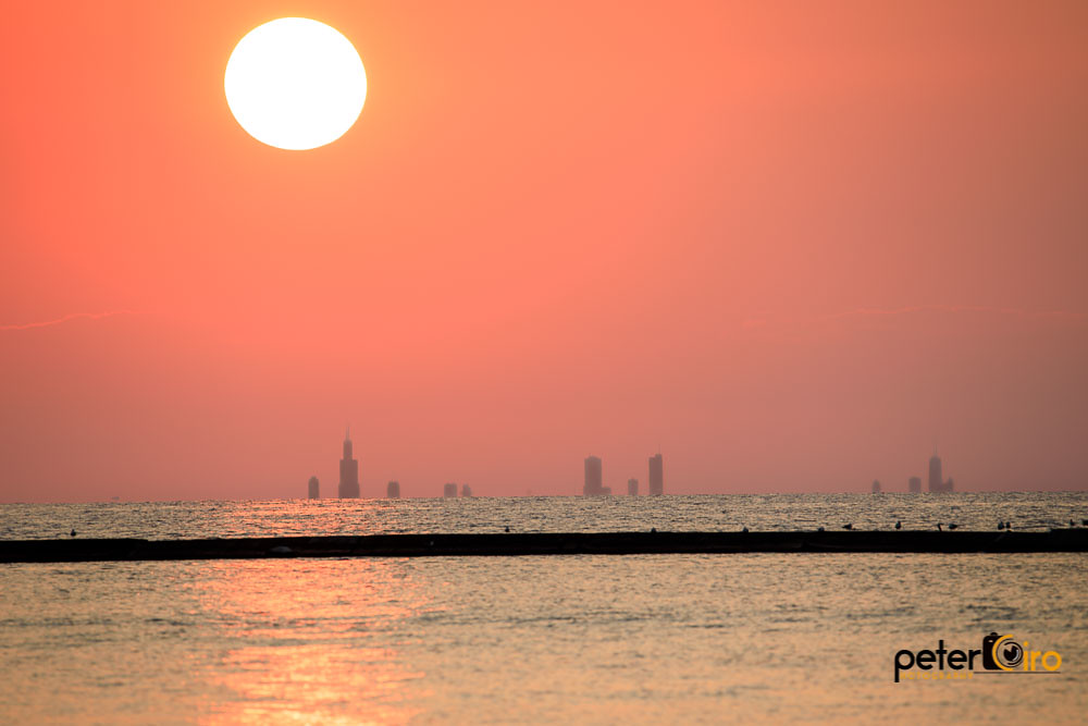 Sun Settting Behind The Chicago Skyline From Michigan City Flickr