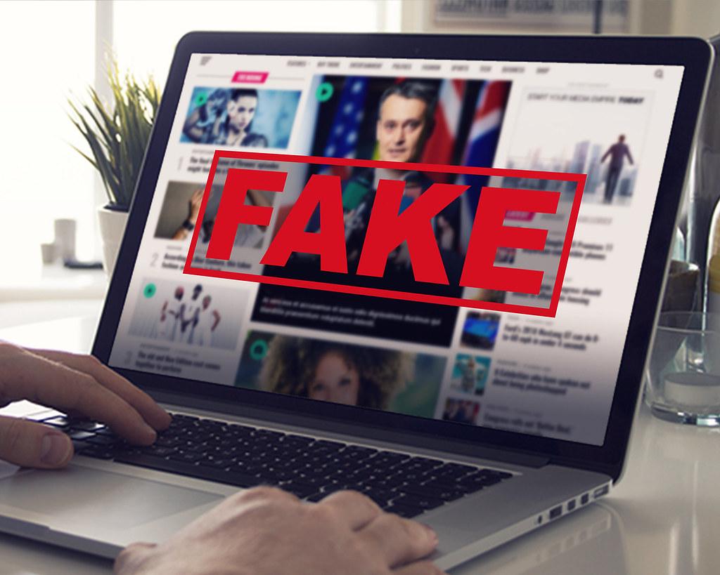 Fake News - Computer Screen Reading Fake News