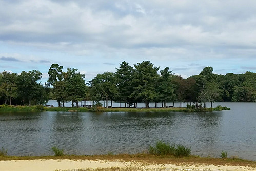 water lake island sand tree trees nature sky clouds park lagoon inlet bridgetonnj