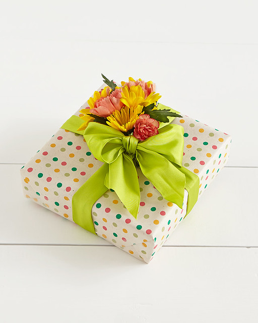 gift wrapped with green bow and oink and yellow flower