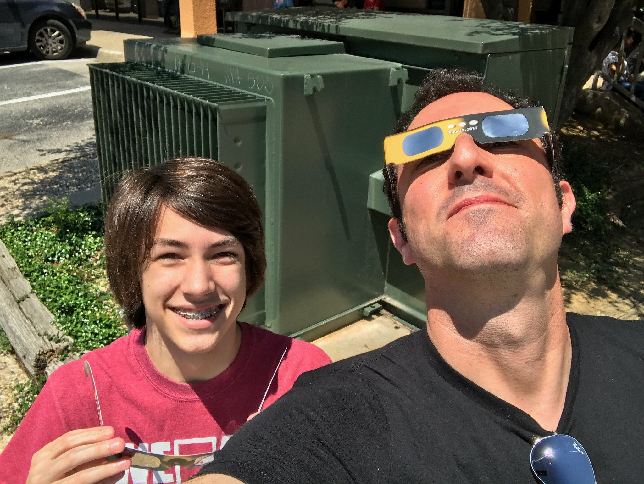 Father and son enjoying the eclipse