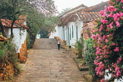 Student Walking Cobblestone Street, Barichara Colombia