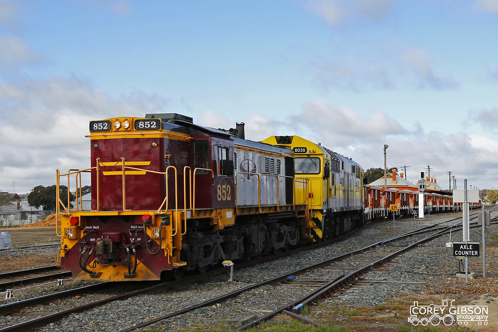 Ballast train with Locomotive's 852 & 8030 departing Temora by Corey Gibson