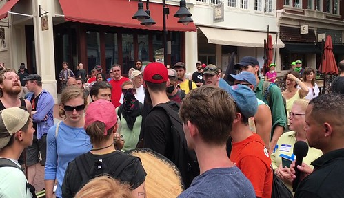Crowd surrounds white supremacists | by evannesterak