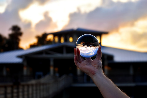 glass ball green cay crystalball glassball greencay greencaynaturecenter greencaywetlands grass buildings southflorida silhouette sky sunset sun sflwetlands florida floridaphotography floridawetlands floridasunset colorful clouds calm round reflection reflective shiny flickr september october october12017 2017 hand clear sharp blurry outdoor outside colors prettysunset water lake trees lights sunlight red orange yelloq yellow blue cloudy contrast bmadhudson