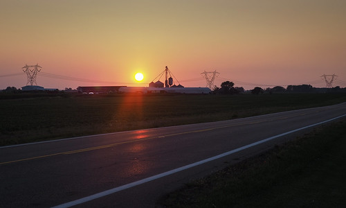 rural sunset sundown evening twilight road country farm field electric pylon tower wires transmission sky sunlight landscape reflection light color colorful