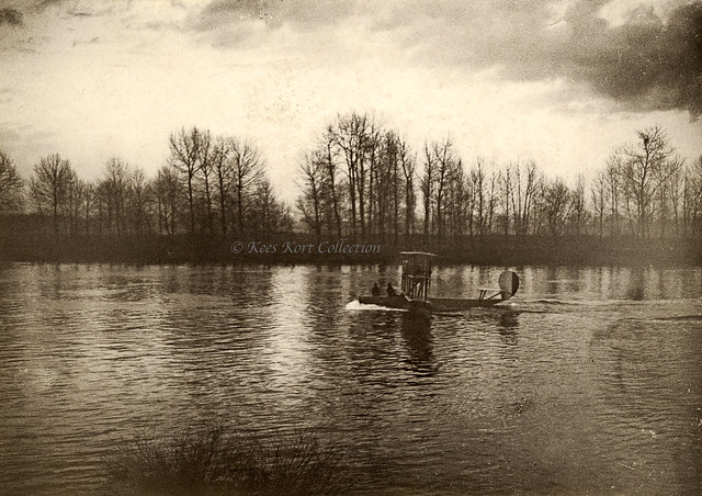 An unidentified Besson triplane flying boat taxiing over the river Seine [France, 1915 - 1918]