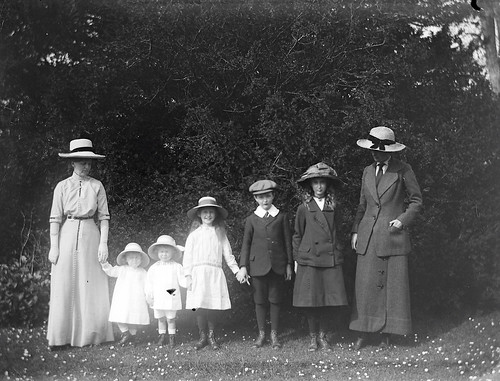 Mote, family 1914. Group of women and children standing in line, two women four girls and a boy   by National Library of Ireland on The Commons
