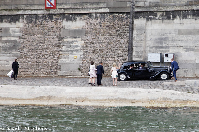 Bride and Groom Leave In Classic Car - On Shore Of Seine