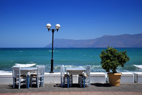 summer mood blue landscape seascape view ropotamos hill mountain peninsula seafront coast coastline lamp table chairs restaurant kissamos crete kreta kriti greece greek sunny hot plant water sea maditerranean bay