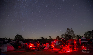 Telescopes slewing and red lights streaking