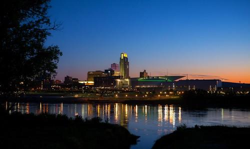 ne nebraska omaha sunset evening dusk city downtown buildings vivid peaceful river urban bridge lights