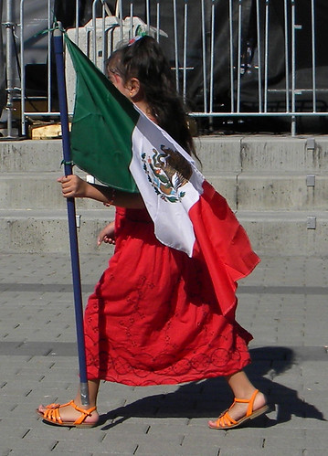 Girl with a flag on Mexican Independence Day