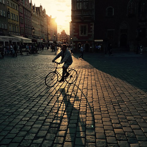 light shadow bike rynek street holidays ray sun august iphone breslau wroclaw poland