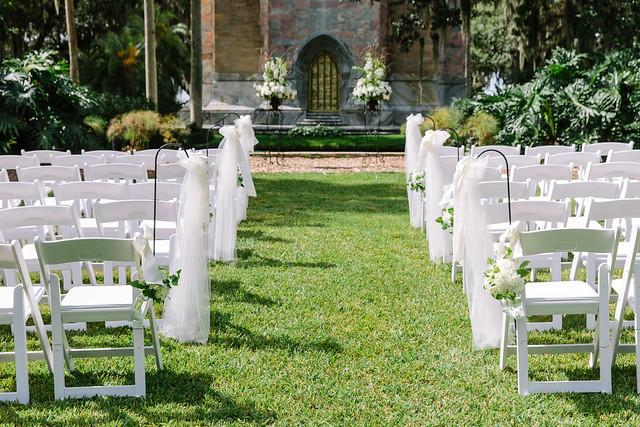 Wedding in Bok Tower Gardens in front of the singing tower and brass door