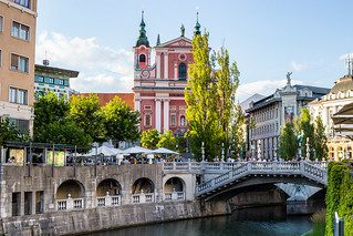 Triple Bridge and the Franciscan Church of Annunciation seen from the Bridge over Ljubljanica River, Ljubljana, Slovenia | by MedCruiseGuide.com