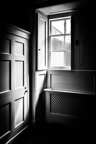 window door shade shadow sunlight blackandwhite bw black white architecture contrast dark light glass indoor lines monochrome squares simonandhiscamera vignette