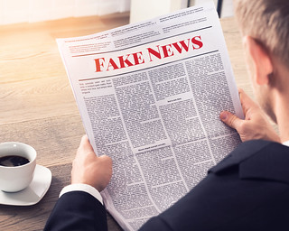 Fake News - Person Reading Fake News Article | by mikemacmarketing