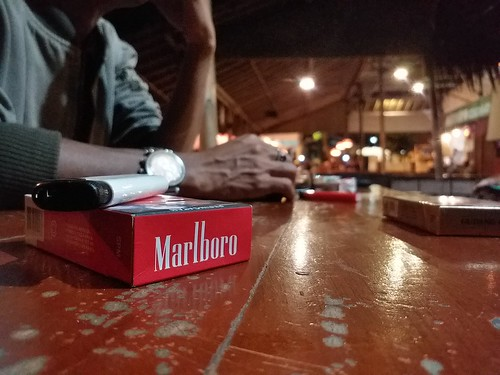 marlboro human man cigar cafe night culture cigarette table samsungj7prime samsungsmg6100