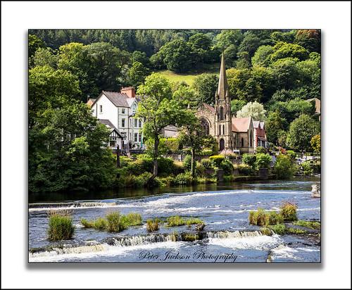 llangollen denbighshire riverdee methodistchurch waterfall water rocks trees houses