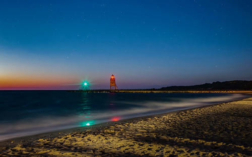 stones shore sand beach stars sky color reflections railing pier exposure long waves nightfall dusk dark evening night sundown sunset sunlit sun charlevoix michigan lake lighthouse light