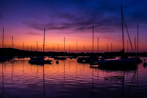 sunrise sailboat lake scenic water reflection sunset sun clouds canon 80d minneapolis minnesota