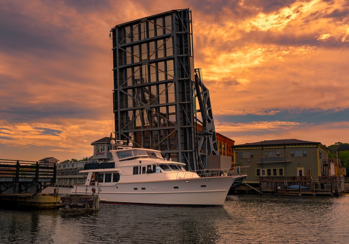 drawbridge basculebridge mysticriver mysticconnecticut yacht boat sunset clouds sky architecture
