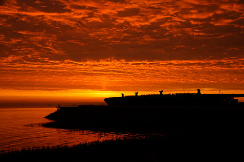 waterside veiwing building centre architecture humberestuary river humberside shoreline sunrise silhouettes tidal clouds morning dawn roof airintakes lightdomes bartonuponhumber eos1dxmk2 sp70200mmf28 tamron canon northlincolnshire skyscape sky water