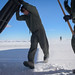 Tech. Sgt. Kyle Ray and Airman 1st Class Ryan Rhoads, loadmasters with the 139th Airlift Squadron, level an LC-130 Hercules aircraft ramp in deep snow at Raven Camp, Greenland, July 30, 2017. Raven Camp is used to train aircrews on LC-130 operations on snow runways. (U.S. Air Force photo by Tech. Sgt. Greg C. Biondo/Released)