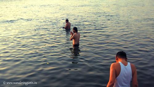 Dipping in Narmada River   by wanderingjatin