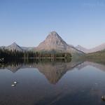 Sinopah reflecting in Two Medicine Lake