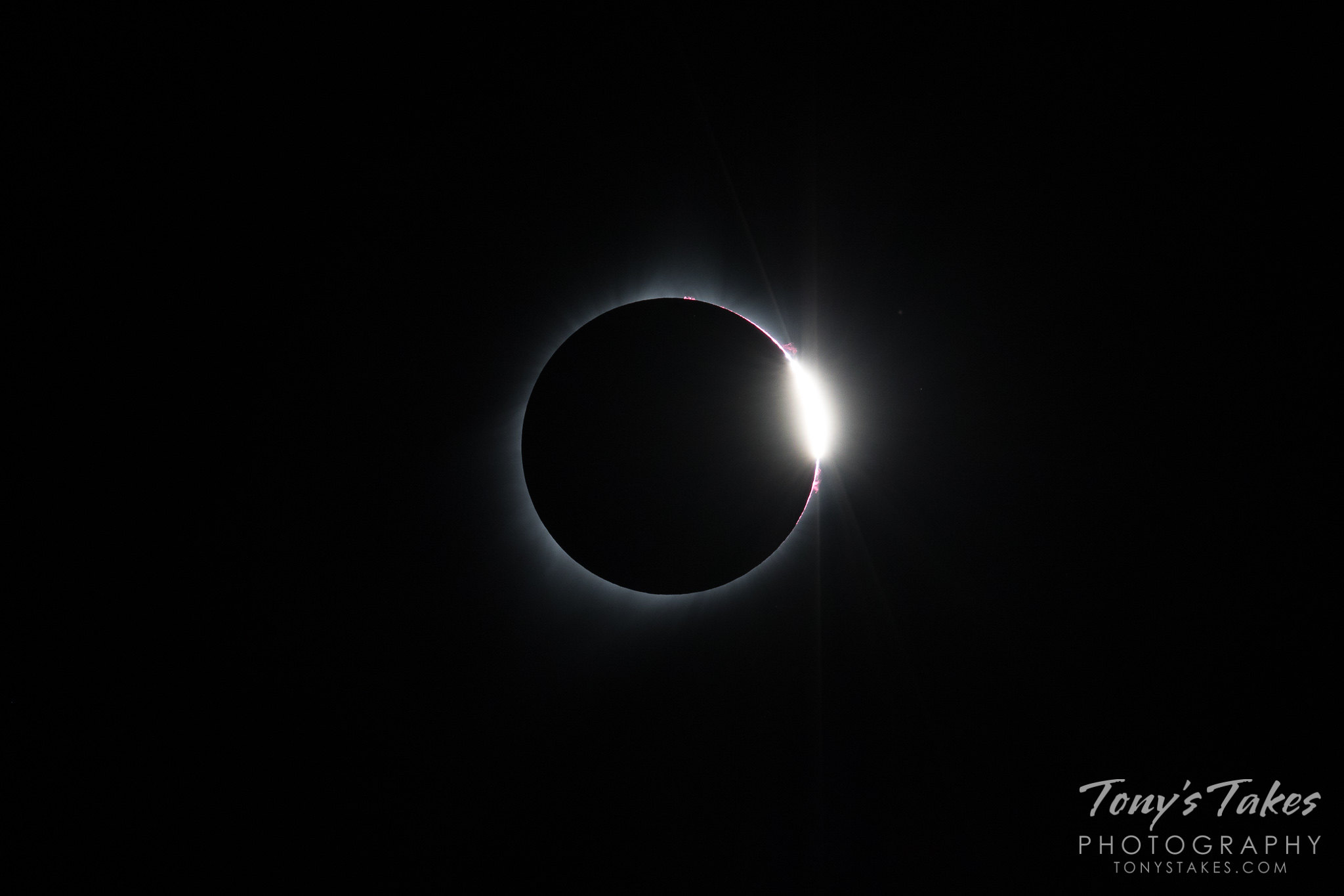 Solar eclipse shows the diamond ring and prominences