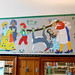 Vitrolite mural in the Children's Library. State Librarian Beverly Cain and Bill Morris visited the Toledo Lucas County Public Library (TLCPL) on July 27, 2017