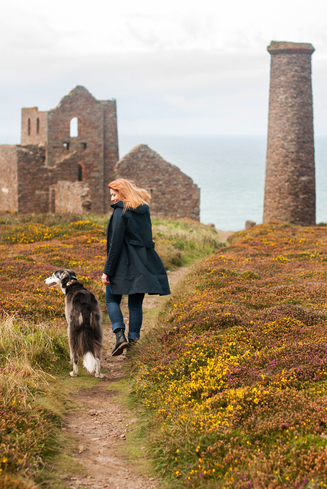 Stylish dressing for a rainy day - wearing AW17 Seasalt Cornwall in St Agnes, Cornwall: Longline navy raincoat \ grey Fair Isle sweater jumper \ blue corduroy trousers \ navy Chelsea boots | Not Dressed As Lamb, over 40 style