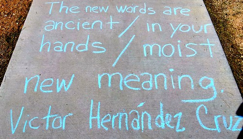 Chalking from  Median Poems by Victor Hernández Cruz in the Malvern Plaza.  (Urban Poetry Pollinators)