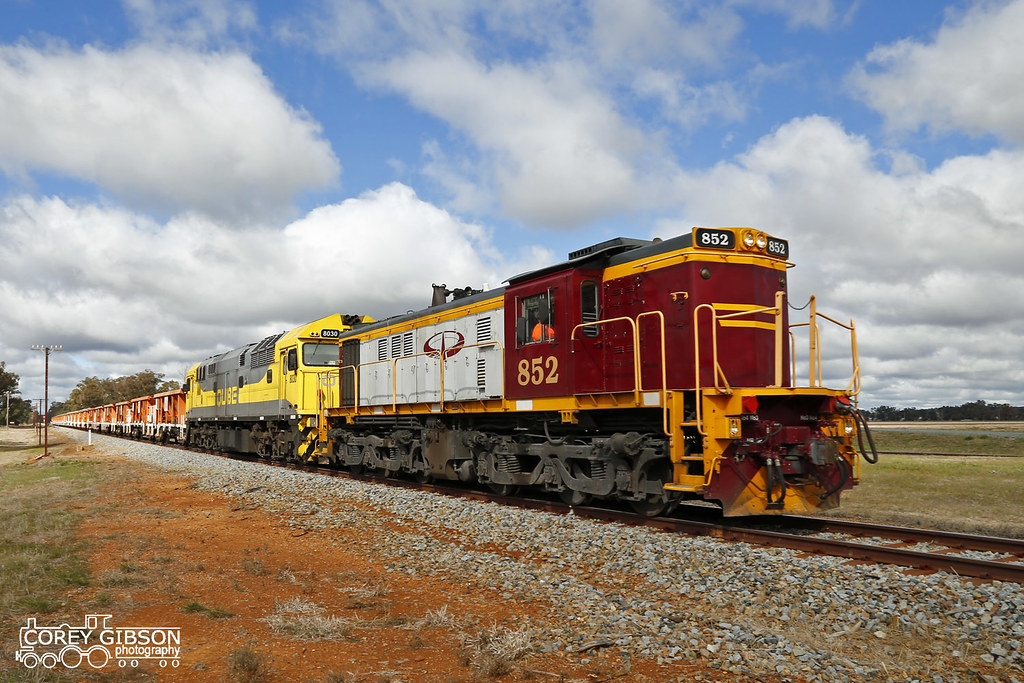 Ballast train with Locomotive's 852 & 8030 by Corey Gibson